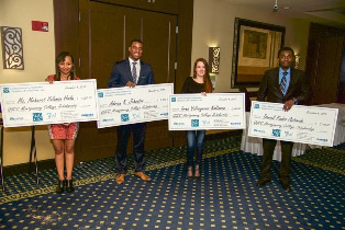 (l:r) Montgomery College students Meheret Solomon Hailu, Adrian K. Johnsto, Irina Valeryevna Koltsova & Daniel Kudzo Asiamah were awarded scholarship checks at the Gaithersburg-Germantown Chamber Annual Celebration Dinner in December. (Photo Credit: Phil Fabrizio, Sugarloaf Photography by Fabrizio)