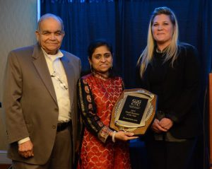 (l:r) Vrajnish Shah & Dipali Shah of ELaunchers.com are presented the Gaithersburg-Germantown Chamber's 9th Annual Small Business of the Year Award from Kelly Lozano of CFR Engineering at the chamber's Annual Celebration Dinner on December 3. (Photo Credit: John Keith Photography)