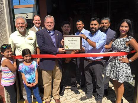 (l:r) Michael Sesma, City Gaithersburg Councilmember; Stuart Barr, Attorney, Lerch, Early & Brewer, Chartered; Jud Ashman, City Gaithersburg Mayor; Mario Arbaiza, Owner, La Casita CA Cocina; Samuel Jimenez, General Manager, La Casita CA Cocina; Jaime Arbaiza, Owner, La Casita CA Cocina; John Angel Arbaiza, Owner, La Casita CA Cocina; and  Iris Veronica Jimenez, Owner, La Casita CA Cocina celebrate the grand opening of their new restaurant - La Casita CA Cocina -  in Old Towne Gaithersburg with a GGCC conducted Ribbon Cutting Ceremony on August 26, 2016.   (photo credit: Laura Rowles, GGCC Director of Events & Marketing)