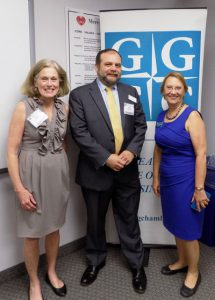 (l:r) Joan Ronnenberg, Director of Development and Communication, Mercy Health Clinic; Mark Foraker, Executive Director, Mercy Health Clinic; and Marilyn Balcombe, Executive Director, Gaithersburg-Germantown Chamber at the Chamber's Business Networking Before Nine mixer on June 13, 2017 at Mercy Health Clinic in Gaithersburg.