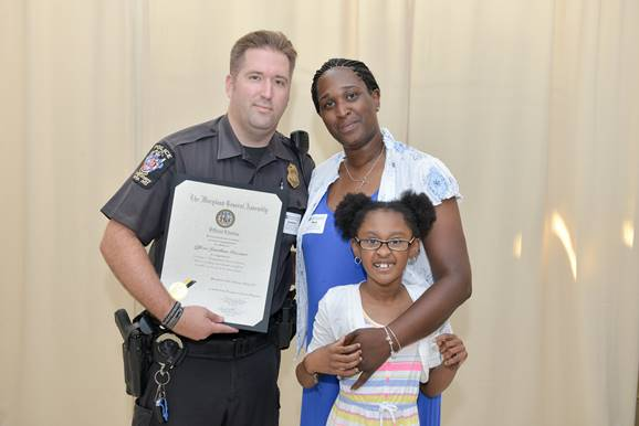 (l:r) Montgomery County Police, 5th District Officer Jonathan Pruziner, Mary & Sahara Wimpy were excited to be able to honor Pruziner with the Distinguished Service Citation after he saved the life of Sahara Wimpy, an autistic child, who had gone missing. (Photo compliments of Phil Fabrizio, PhotoLoaf® - Live. Love. Play. Loaf.)