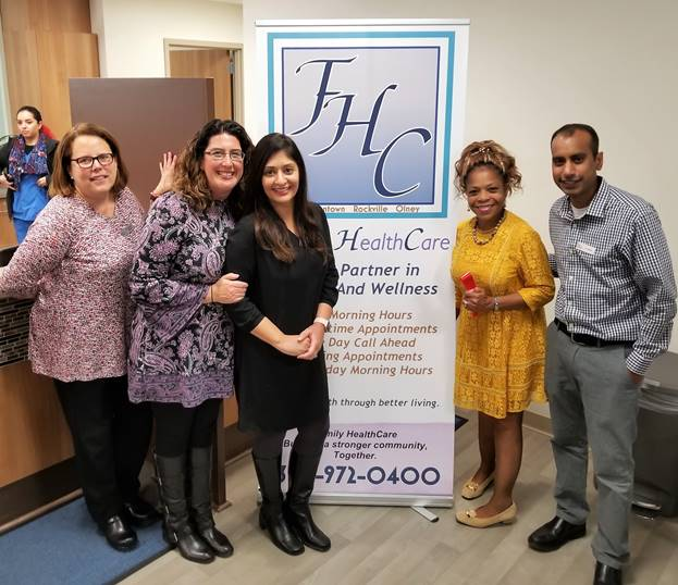 (l:r) Family HealthCare, P.C.'s Dr. Martha Skurla, M.D.; Dr Megan Wollman– Rosenwald, M.D; Dr Rita Sharma, M.D.; Dr Monica Howard, D.O., Managing Partner; and Dr Jimmy Sheikh, M.D. at their ribbon cutting celebration. All the doctors in the practice are Family Medicine. Their new office is on the campus of the Germantown Holy Cross Hospital. (photo credit: Laura Rowles, GGCC Director of Events & Marketing)