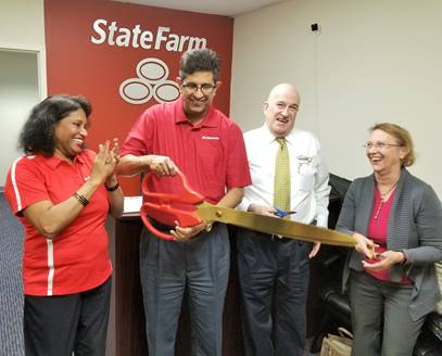 (l:r) Rajeshri Konadkar, Manager, State Farm; Manny Pohani, Owner / Licensed Agent, State Farm; Bruce Kanner, Owner, Imaging Supply Specialist, Cartridge on Wheels & Gaithersburg-Germantown Chamber Board Member; and Marilyn Balcombe, President / CEO, Gaithersburg-Germantown Chamber celebrate - with smiles and laughter - the grand opening of State Farm Insurance Pohani.  (photo credit: Laura Rowles, GGCC Director of Events & Marketing)